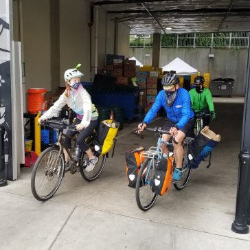 Seattle Pedaling Relief Project volunteers deliver food by bike for University District Food Bank. Credit: The Seattle Pedaling Relief Project