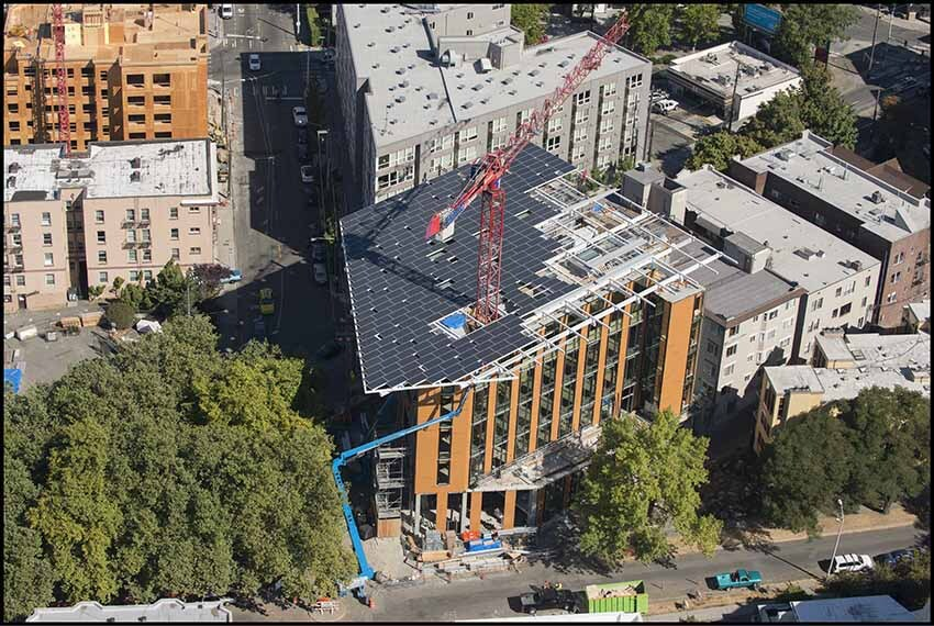 The Bullitt Center, current home to International Living Future Institute and soon-to-be home to Beneficial State Bank, during construction in 2012. The Center is certified by ILFI's rigorous Living Building Challenge for its sustainable design.